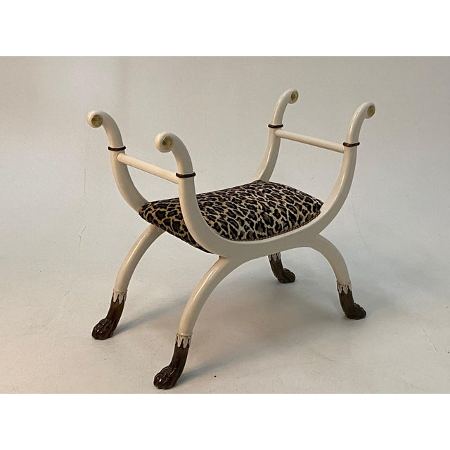 Super chic Regency style bench having white lacquer wood with black and brass accents and sensual curvy shape. Seat is...