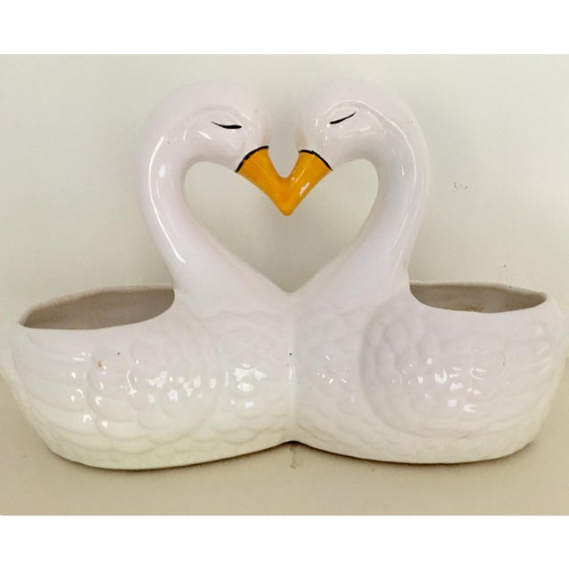 Vintage planter in the form of sweetheart kissing white swans. Their touching beaks and the curve of the necks form a...