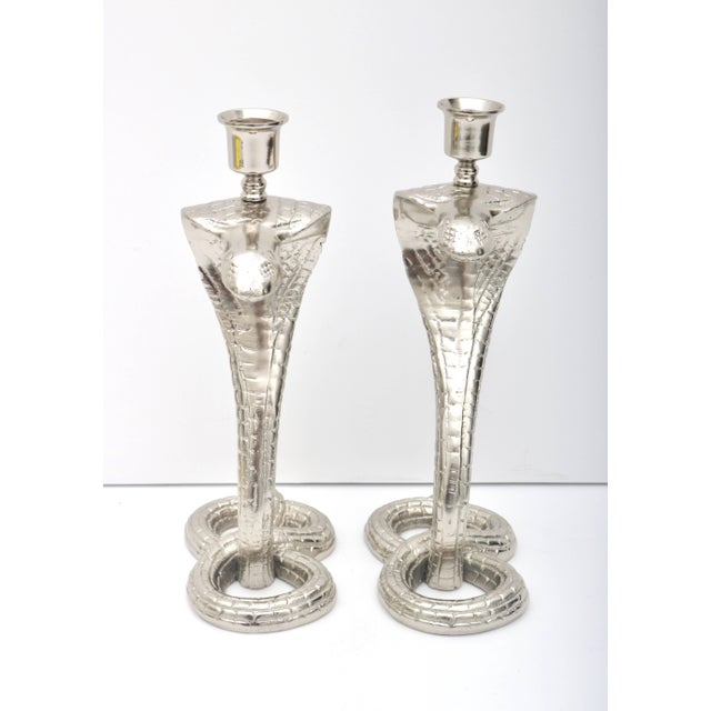 This stylish and exotic pair of cobra-form candle sticks date from the 1920s during the height of the Tutankhamun...