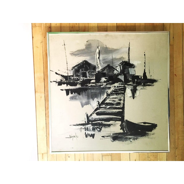 Vintage monochromatic painting of an ocean side dock village, mounted in a silver metal frame and signed on the lower left...