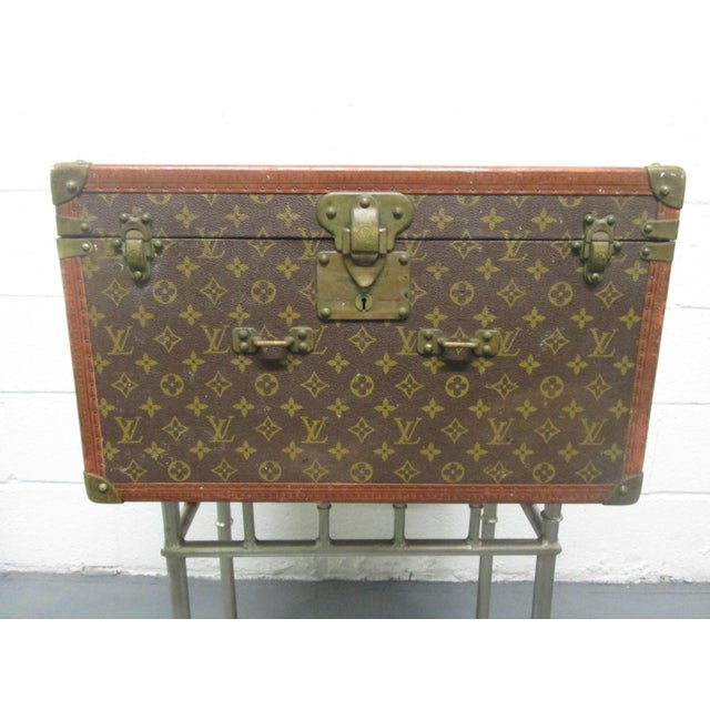 Vintage Louis Vuitton trunk / hat box. Has silk interior with four corner pockets. Monogrammed on canvas with leather and...
