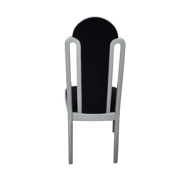A lovely Art Deco style dining chair, made in Italy. The chair features a tall rounded back upholstered in a lush black...