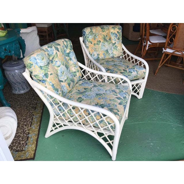 It doesn't get any more old Florida Coastal than this sweet pair of vintage Rattan chairs with criss cross patterns and a...