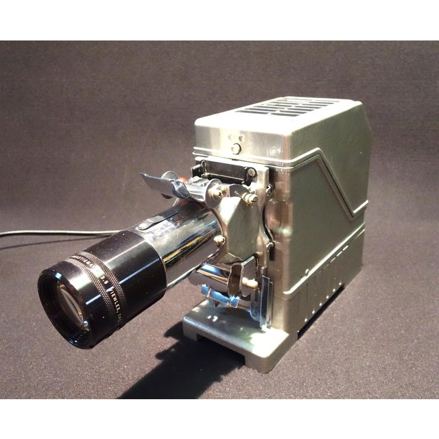 Submitted for your approval is this beautifully original View Lex, Circa 1950 Film Projector. Bold in its deco like...