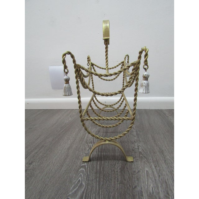 Rope & Tassel in Metal Magazine rack with sections. The Regency Style Rack has an arched handle , and with all form, is in...