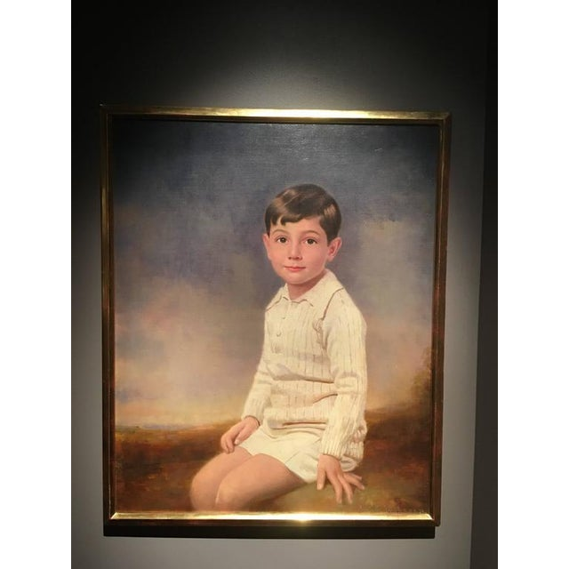 Utterly charming three-quarter portrait of a young boy in play clothes from the early 20th century. Signed and dated...