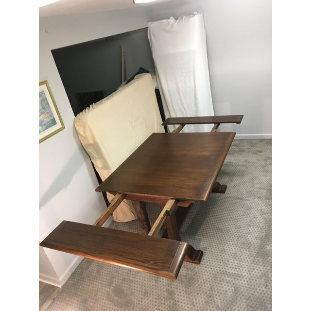 The set consists of a seat 12 table with 2 extensions and pads, six matching chairs. a base cabinet and lighted hutch...