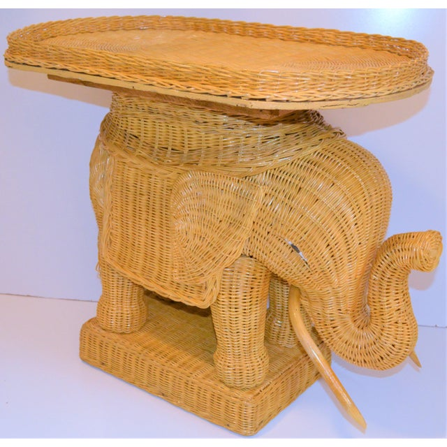 """We are offering a new slightly """"older stock"""" wicker elephants with a tray stand on top. This is in excellent condition...."""