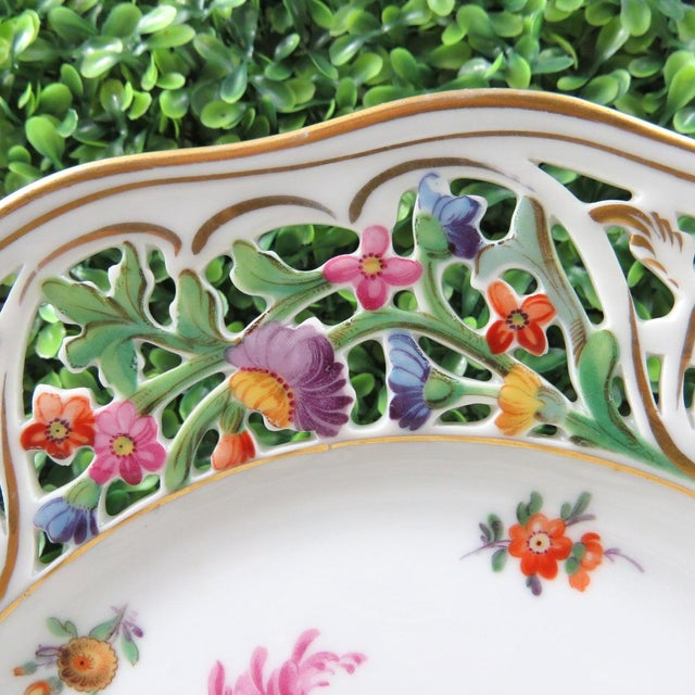 Gorgeous Schumann floral reticulated dinner or cabinet plate. The elaborately reticulated blank is known as Chateau. The...