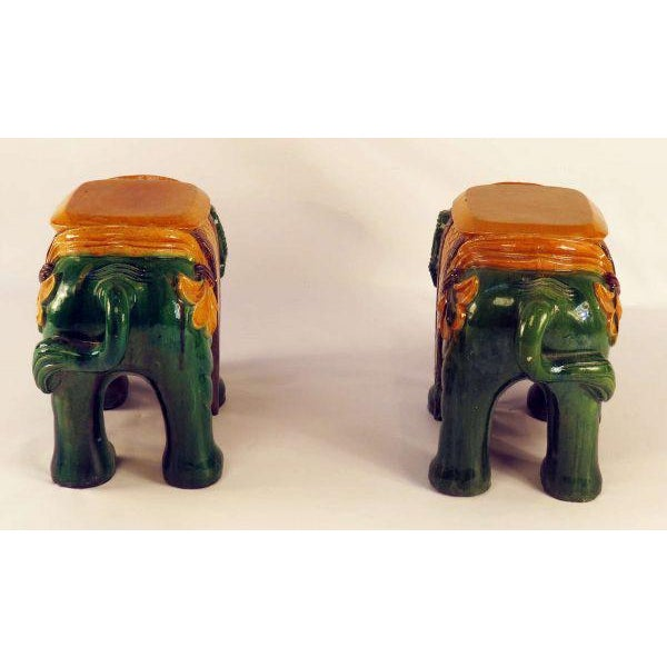 A very nice early pair of Chinese Ching dynasty green glazed elephant garden seats made circa 1850. Exceptional iridescent...