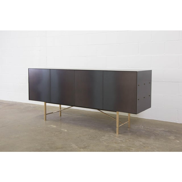 The Connect credenza is emblematic of the contemporary interweaving of mass manufacturing and traditional joinery...