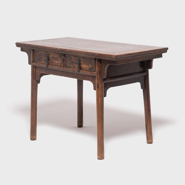 Crafted of northern elmwood in China's Shanxi province, this early 19th-century altar table was once used to display an...
