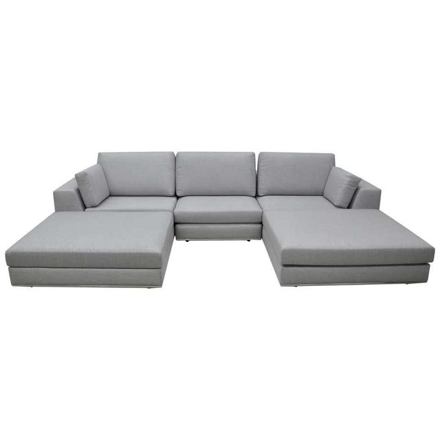 A contemporary light grey couch that can be configured many different ways: as a three seat sofa, two seat settee,...