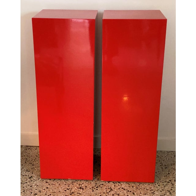 This stylish and dramatic pair of custom red lacquered pedestals will definitely help your sculpture make a statement. The...