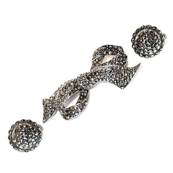 C.1930/40's gorgeous vintage set that includes a sterling bow-shape brooch encrusted with marcasites and paired with...
