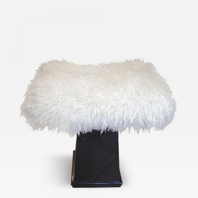 Spectacular Danish stool in black lacquered wood and real fur.
