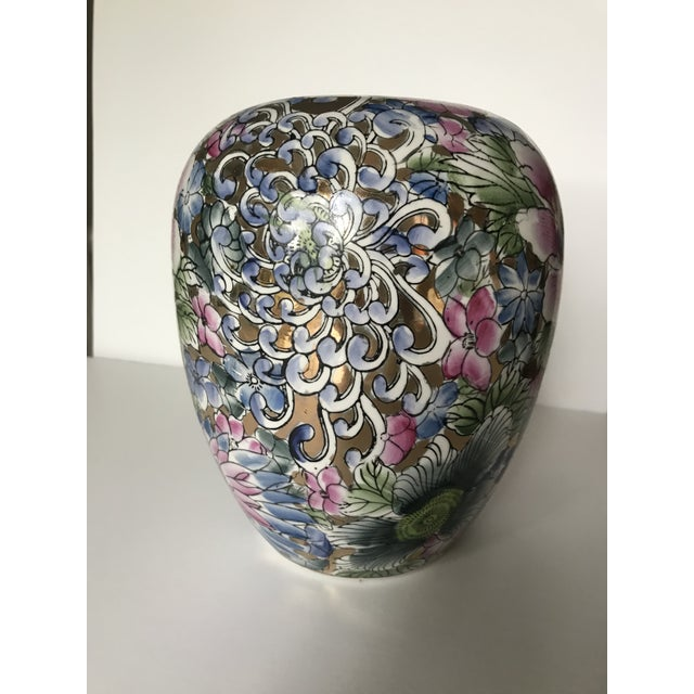 Beautiful ceramic vase with colorful florals and gold accents. This chinoiserie style vase is in the shape of a classic...