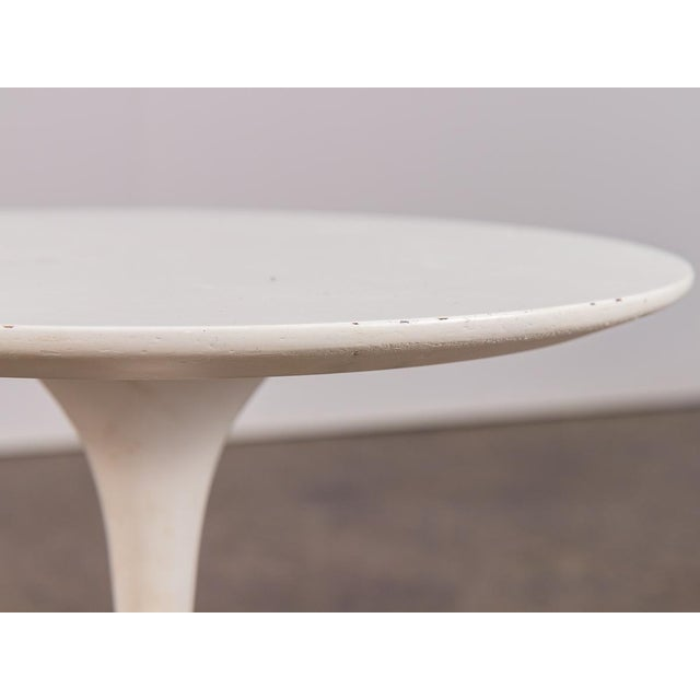 Eero Saarinen white Tulip Side Table for Knoll. This petite version of the large Saarinen Tulip dining table echoes the...