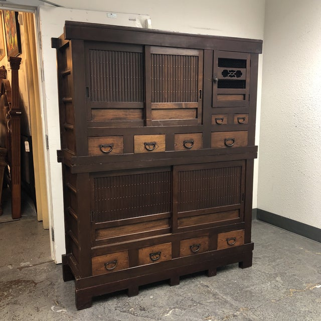 Design Plus Galley presents an Antique three piece Japanese Tansu cabinet.  The cabinet provides eight - Antique Japanese 3 Piece Tansu Cabinet Chairish