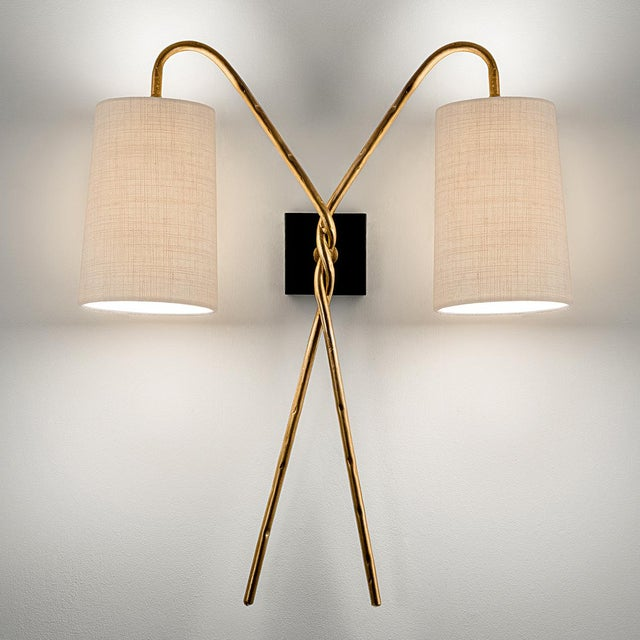 Florentine antique gold wall light made from hand wrought iron tubing and a distressed gold patina twisted to form two...