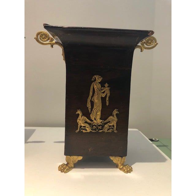 Exceptional pair of French Napoleon III mahogany and gilt bronze cachepot. Original gilt bronze mounts and lions paw feet....