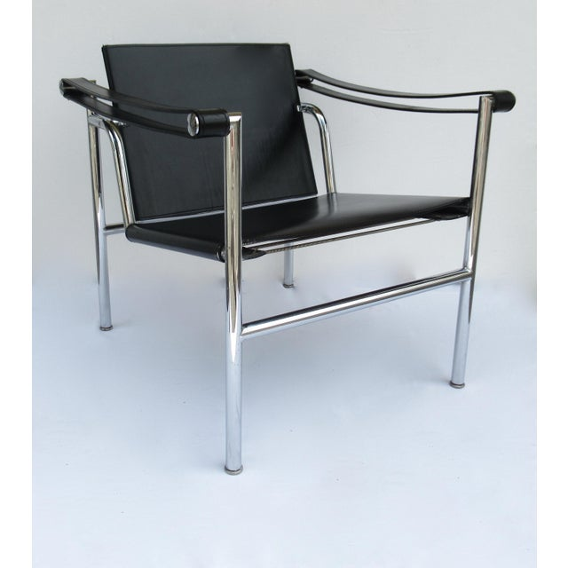 Vintage: Le Corbusier, LC1 Basculant, chrome and black saddle leather strapped, sling lounge chair. This wonderful, iconic...
