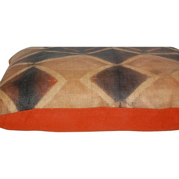 Tie-dye pillow made from decorated panels that were used for wrapping as a skirt by the Kuba people in the early-to-...