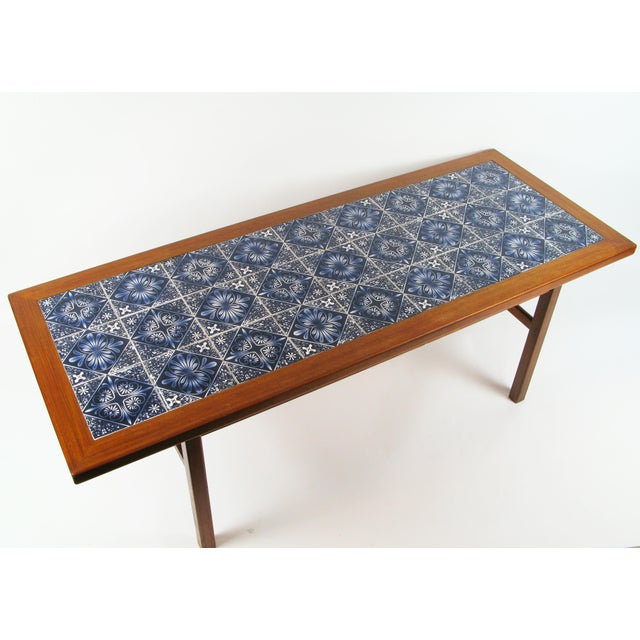 This is a great example of creativity by Danish modern designers. By combining teak and Royal Copenhagen tiles they have...