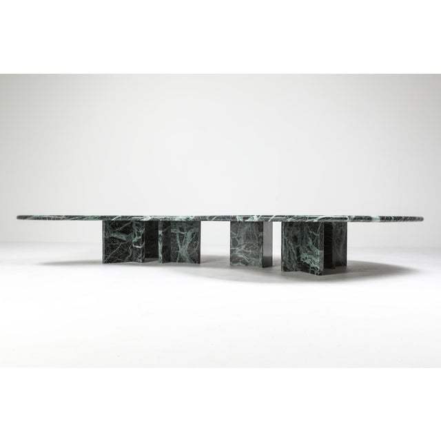 Late seventies pair of coffee tables in green marble which belong together like yin and yang. Feels like a collab between...