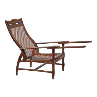 Planter's chair in teak, cane and brass, Italy, circa 1900 For Sale