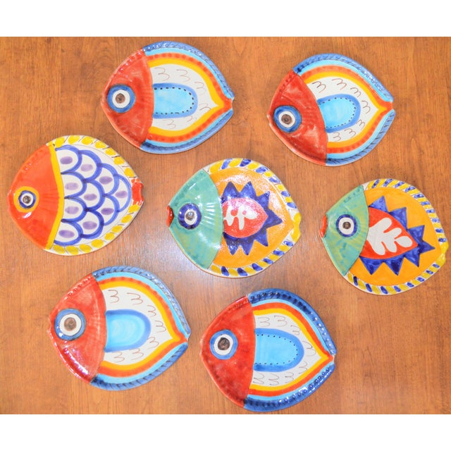 This is a vintage set of 7 fish plates in a heavy terra cotta pottery. It was created by the pottery company DeSimone in...