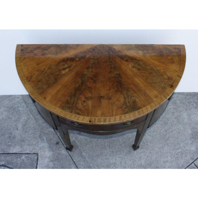 A very elegant and unusually small George III style mahogany demi lune side board made in England late in the 19th...
