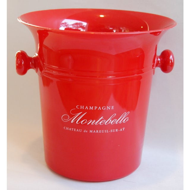 "Vintage French champagne ice bucket cooler featuring a front label that reads ""Champagne Montebello Chateau de Mareuil-..."