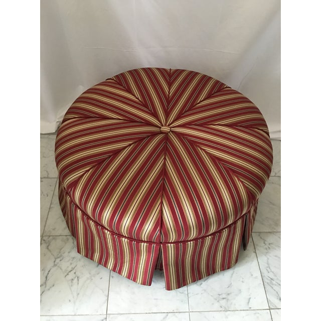 Pristine as the day it was made is this custom Upolsterer round ottoman . Pie shaped, center button tuft , pleated skirt...