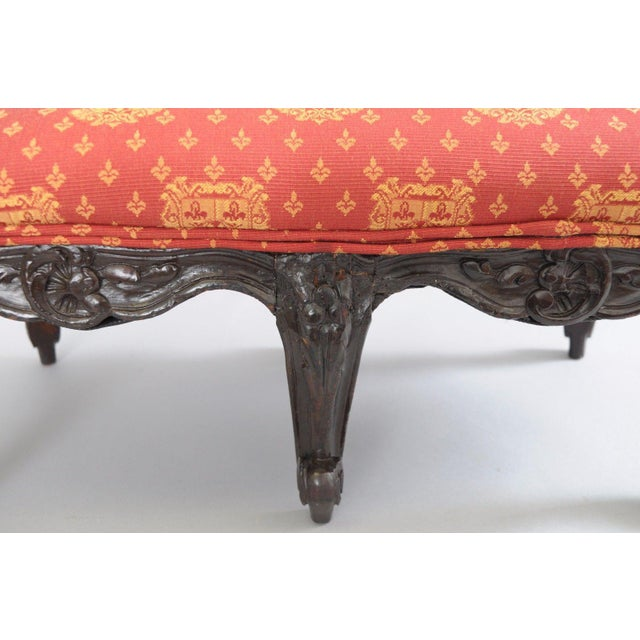Item: Antique Country French Louis XV Style Carved Wood Petite Ottoman Details: Solid carved wood frame, 6 cabriole legs,...