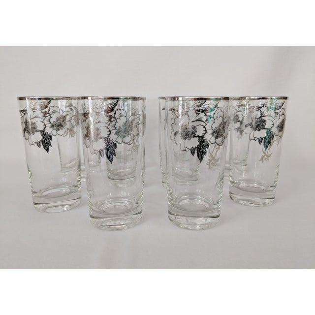 An exquisite set of vintage highboy glasses with sterling silver overlay. These glasses were manufactured by the Rockwell...