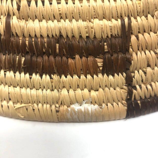 Vintage African deer motif woven basket. In excellent condition.