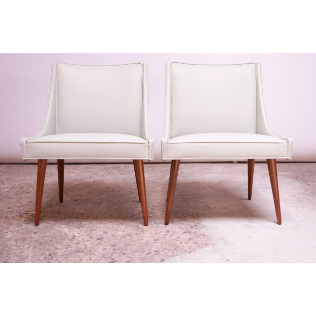 1960s American Modern Slipper / lounge chairs designed by Milo Baughman for Thayer Coggin. Elegant, long tapered legs in...