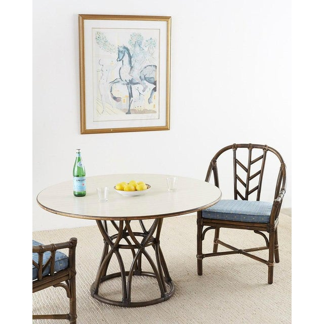 Stylish organic modern round game table or dining table made by McGuire. Features a bamboo rattan basket base with an...
