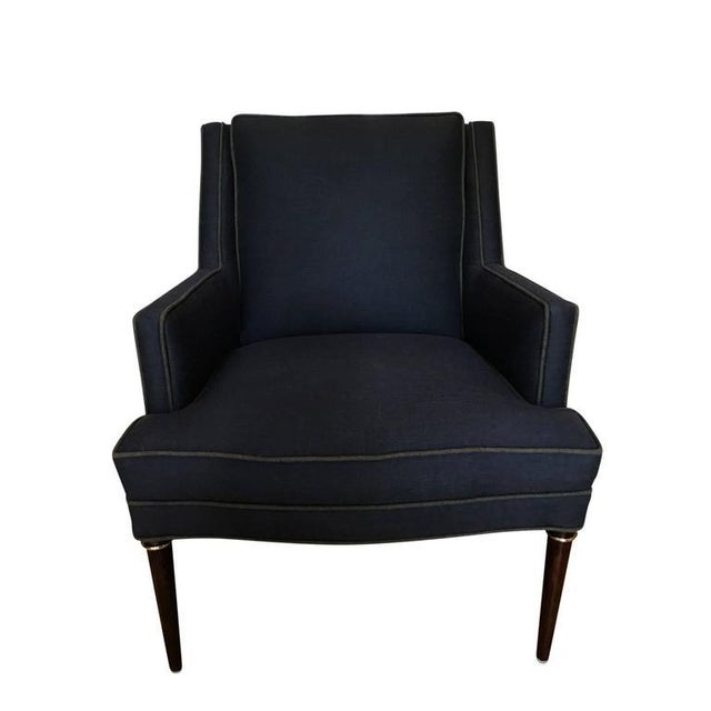 Handsome armchair designed by Edward Wormley for Dunbar. Wonderful structured lines with mahogany legs and brass ring...