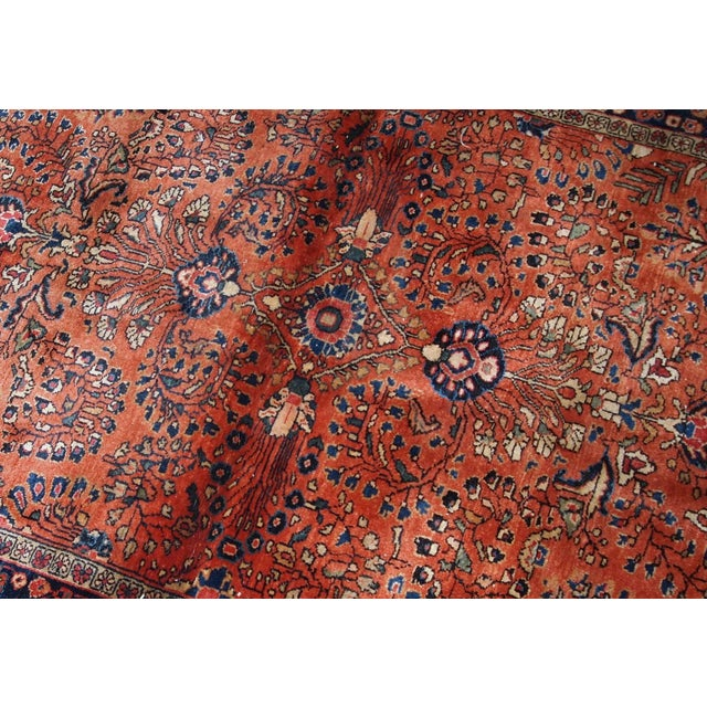 Handmade antique Persian Sarouk rug in original good condition. The rug is from the beginning of 20th century made in...