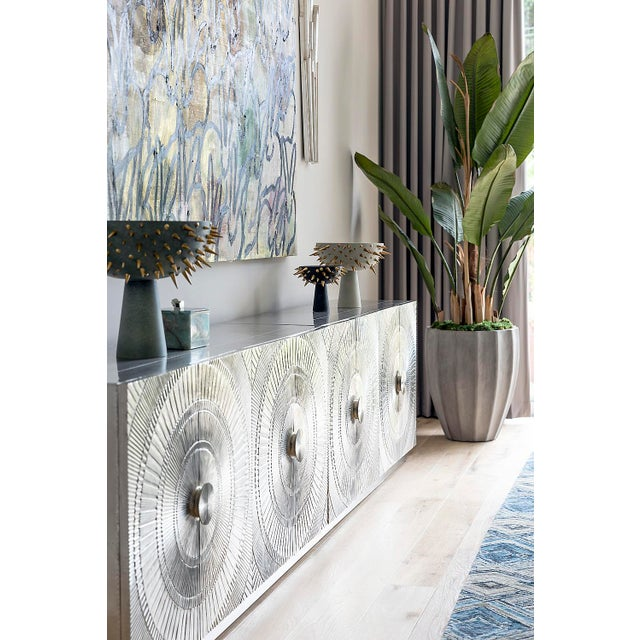 Amazing silver credenza used recently in a show house. German Silver wrapped credenza (including back) with embossed...