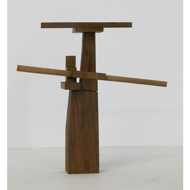 Behzad Haghiri's Unique Raw Walnut Sculpture Each sculpture is different. This resembles a statue.