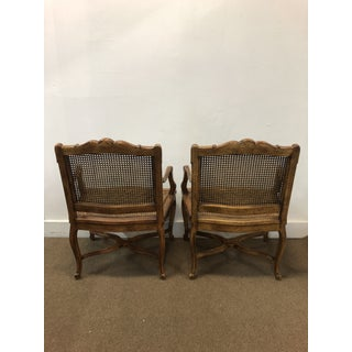 1970s Vintage Regence Cane French Carved Arm Chairs- a Pair Preview