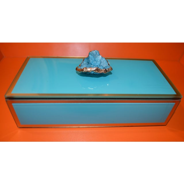 This is a very eye-catching little rectangular trinket box with a beautiful blue crystal geode dipped in gold finial. It...