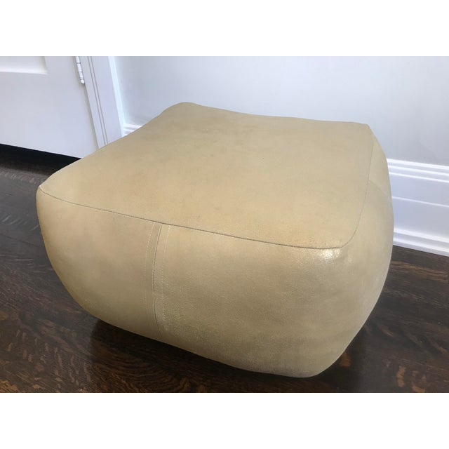 Iconic and rare leather pouf by Dosa Inc. Stuffed with recycled materials left over from their fashion business. They are...
