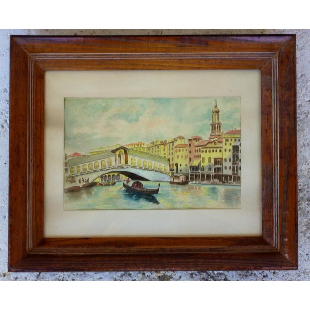 Watercolor of Venice Canal with a gondola meandering through the city and the Rialto Bridge in the background, circa...