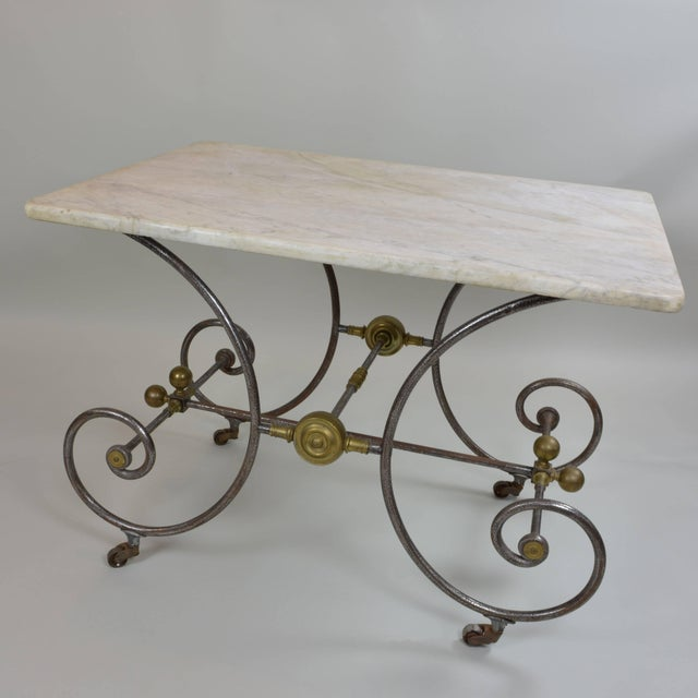Lovely old pastry maker's table from France, circa 1810. Rich, cream-colored marble top; graceful wrought iron frame with...
