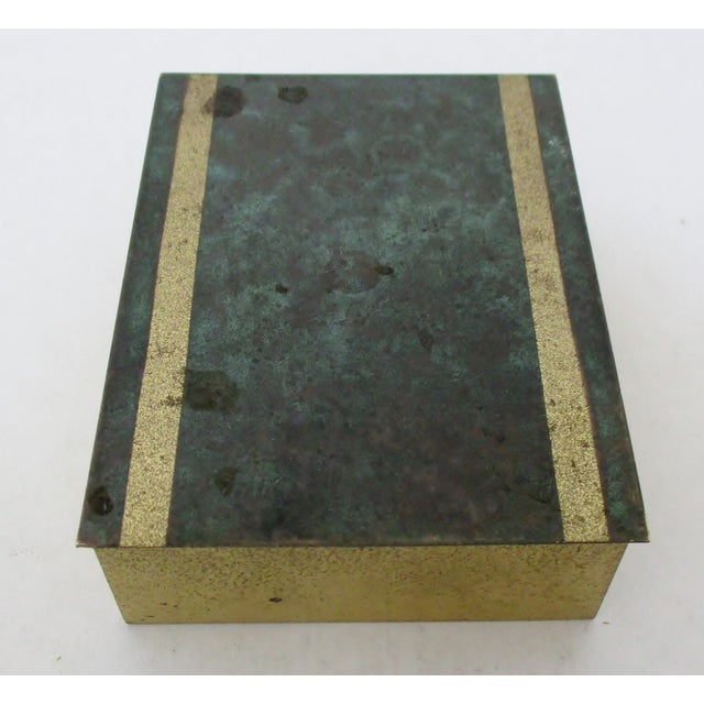 Vintage German distressed brass box with hinged lid that has a faux malachite lid. The box has a wood lining. No maker's...