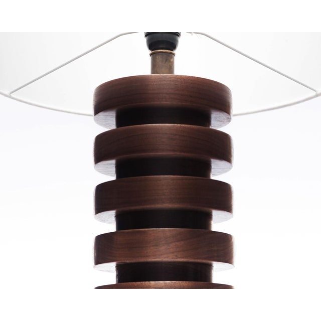 Inspired by the silhouette of Japanese pagodas with a nod to Scandinavian simplicity, the Malmo pure walnut table lamp is...
